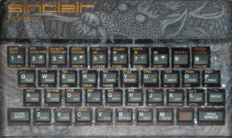 ZX Spectrum computer with an Asian dragon drawn on it, highlighted in gold